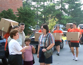 Faculty and staff assist during move in day