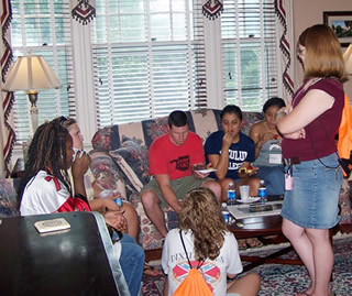 Students gather at a reception before the school year begins
